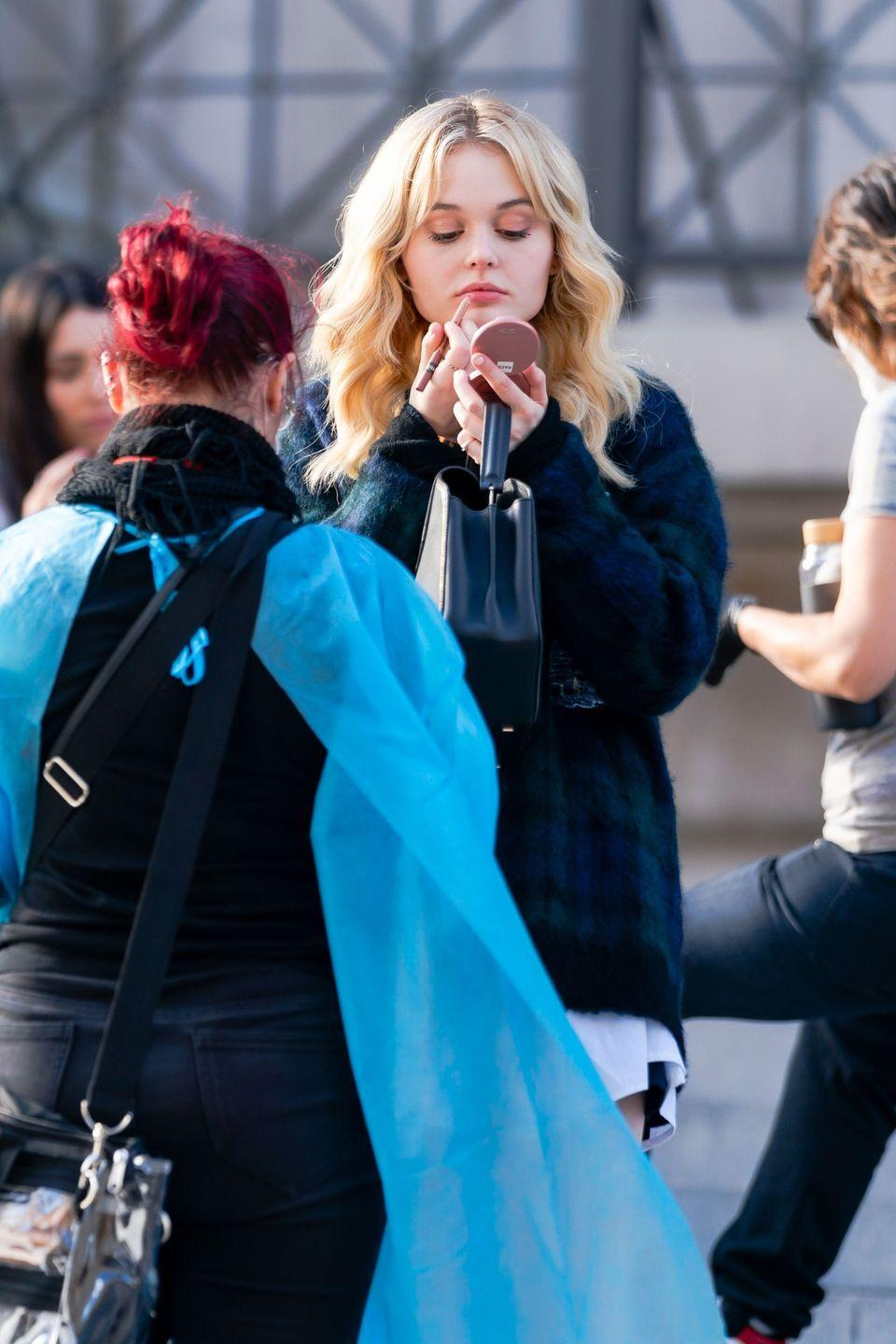 <p>Emily Alyn Lind touches up between takes. </p>