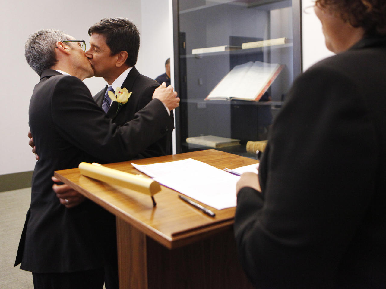 NEW YORK, NY - JULY 24:  Same-sex couple Daniel Hernandez ,53,(R) and Nevin Cohen, 48, kiss after  being married at the Manhattan City Clerk's office on the first day New York State's Marriage Equality Act goes into effect July 24, 2011 in New York City. Today was the first day gay couples were allowed to legally marry in New York State after Gov. Andrew Cuomo signed the historic legislation into law.  (Photo by Shannon Stapleton -Pool/Getty Images)