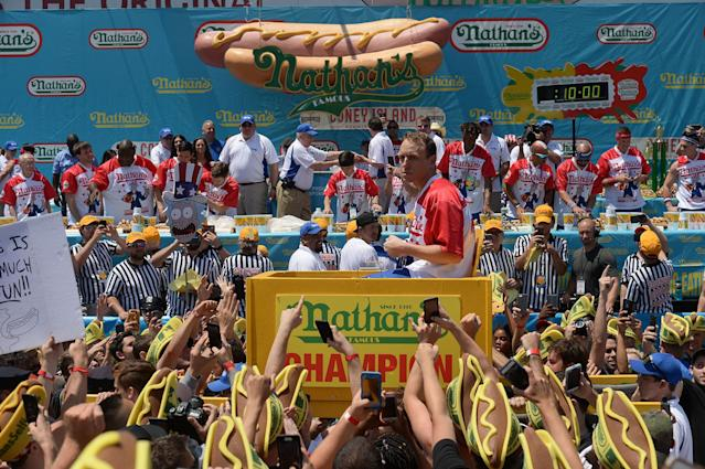 <p>Joey Chestnut is carried to the stage before competing in and winning Nathan's Famous Fourth of July International Hot Dog-Eating Contest at Coney Island in Brooklyn, New York City, U.S., July 4, 2017. ( Erik Pendzich/REX/Shutterstock) </p>