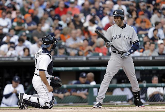 New York Yankees, Derek Jeter, right, laughs with Detroit Tigers catcher Alex Avila while batting in the first inning of a baseball game in Detroit, Wednesday, Aug. 27, 2014. (AP Photo/Paul Sancya)