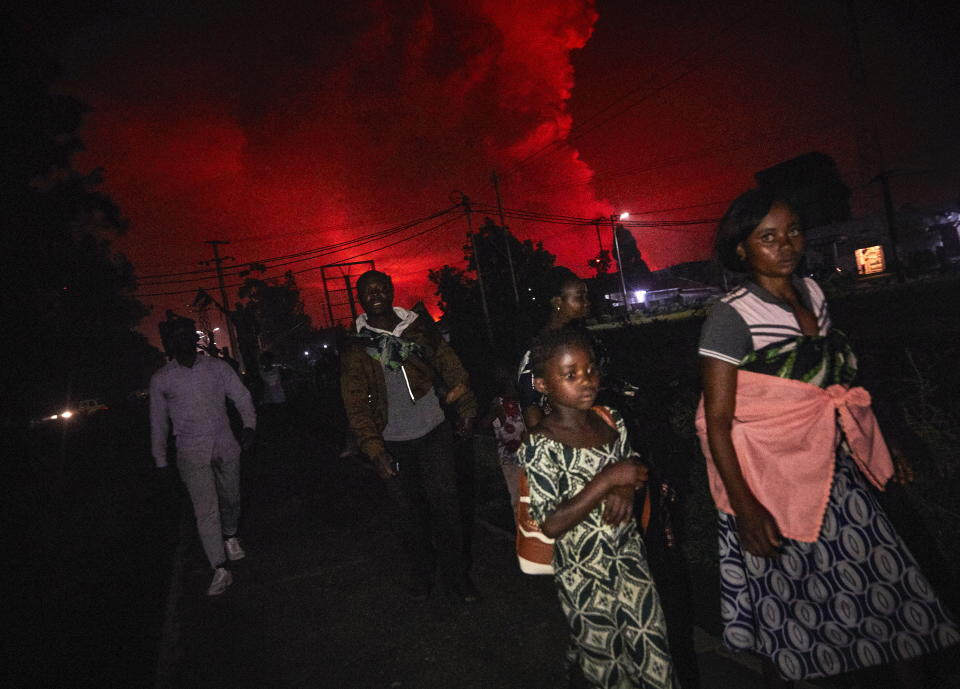 Congolese residents of Goma flee from Mount Nyiragongo volcano as it erupts over Goma. Source: EPA/Hugh Kinsella Cunningham