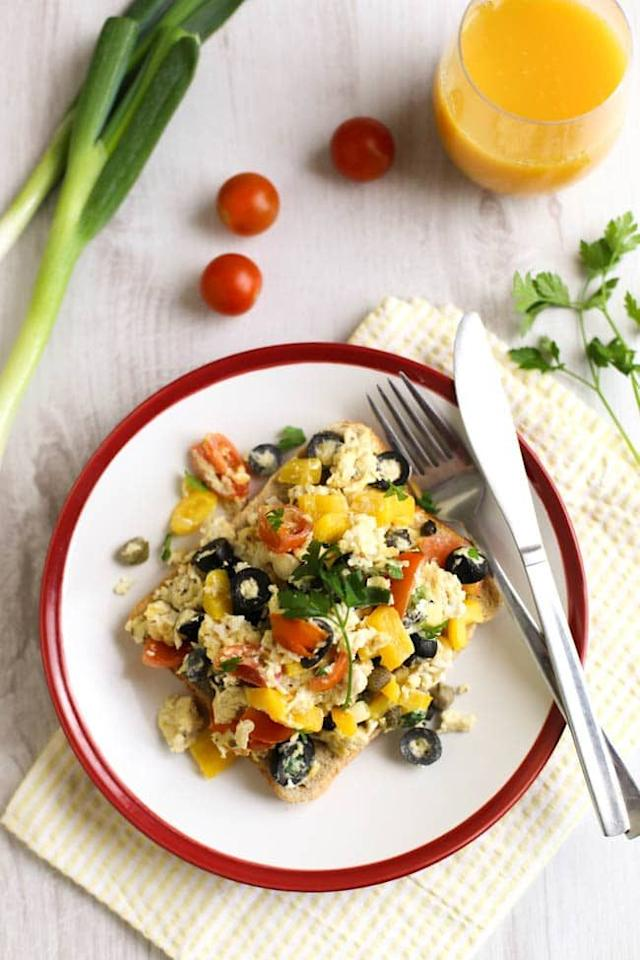 """<p>Scrambled eggs are the easiest things to make, and this heart-healthy breakfast packs in a full serving of veggies like yellow peppers, cherry tomatoes, spring onions, and black olives (well, technically a fruit!). Throw the mix onto a piece of whole grain toast, and you'll be as golden as the Mediterranean sun.</p><p><a class=""""body-btn-link"""" href=""""https://www.amuse-your-bouche.com/mediterranean-scrambled-eggs/"""" target=""""_blank"""">GET THE RECIPE </a></p><p><em>Per serving: 249 calories, 17 g fat (4 g saturated), 13 g carbs, 4 g sugar, 334 mg sodium, 3 g fiber, 14 g protein</em></p>"""