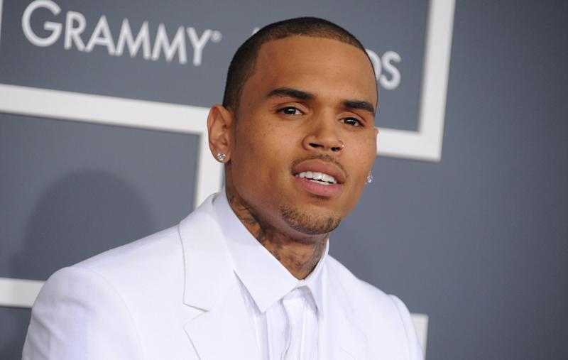 FILE - In this Feb. 10, 2013 file photo, Chris Brown arrives at the 55th annual Grammy Awards, in Los Angeles. Brown was arrested early Sunday, Oct. 27, 2013 in Washington after a fight broke out near the W Hotel near the White House. District of Columbia Police spokesman Officer Paul Metcalf says 24-year-old Brown was arrested and charged with felony assault. Metcalf says 35-year-old Chris Hollosy also was arrested on felony assault charges after the incident. (Photo by Jordan Strauss/Invision/AP, File)