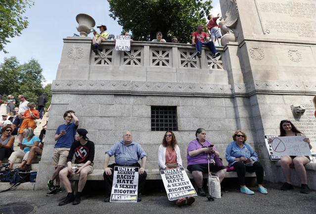 """Counterprotesters assemble at the Statehouse before a planned """"Free Speech"""" rally by conservative organizers begins on the adjacent Boston Common, Saturday, Aug. 19, 2017, in Boston. Police Commissioner William Evans said Friday that 500 officers, some in uniform, others undercover, would be deployed to keep the two groups apart. (AP Photo/Michael Dwyer)"""