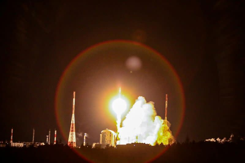 A rocket booster with OneWeb satellites blasts off at the Vostochny Cosmodrome in the Russian Far East