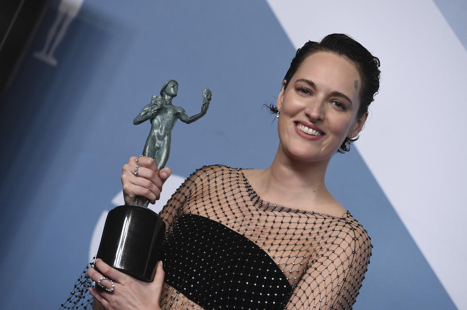 "Phoebe Waller-Bridge poses in the press with the award for outstanding performance by a female actor in a comedy series for ""Fleabag"" room at the 26th annual Screen Actors Guild Awards at the Shrine Auditorium & Expo Hall on Sunday, Jan. 19, 2020, in Los Angeles. (Photo by Jordan Strauss/Invision/AP)"