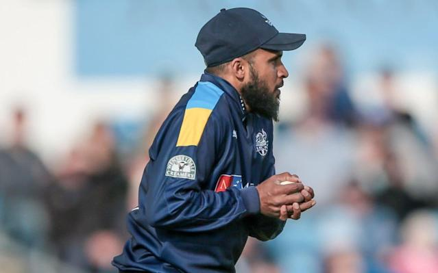 Adil Rashid holds the match-winning catch after impressing with two for 34 for Yorkshire against Lancashire - Rex Features