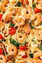 """<p>Linguine with tomatoes, greens, and prawns in a buttery sauce = bomb.</p><p> the <a href=""""https://www.delish.com/uk/cooking/recipes/a30219265/creamy-shrimp-linguine-tomatoes-kale-lemon-zest-recipe/"""" rel=""""nofollow noopener"""" target=""""_blank"""" data-ylk=""""slk:Creamy Prawn Linguine"""" class=""""link rapid-noclick-resp"""">Creamy Prawn Linguine</a> recipe.</p>"""