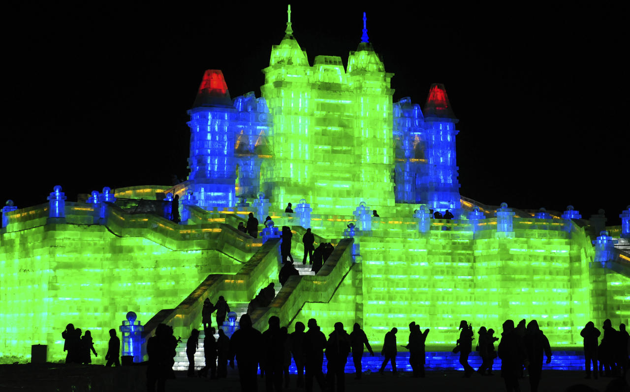 Tourists visit ice sculptures during the the lights testing period of the 13th Harbin Ice and Snow World in Harbin, Heilongjiang province December 25, 2011. The Harbin International Ice and Snow Festival will be officially launched on January 5, 2012. Picture taken December 25, 2011. REUTERS/Sheng Li (CHINA - Tags: ENVIRONMENT SOCIETY TRAVEL)