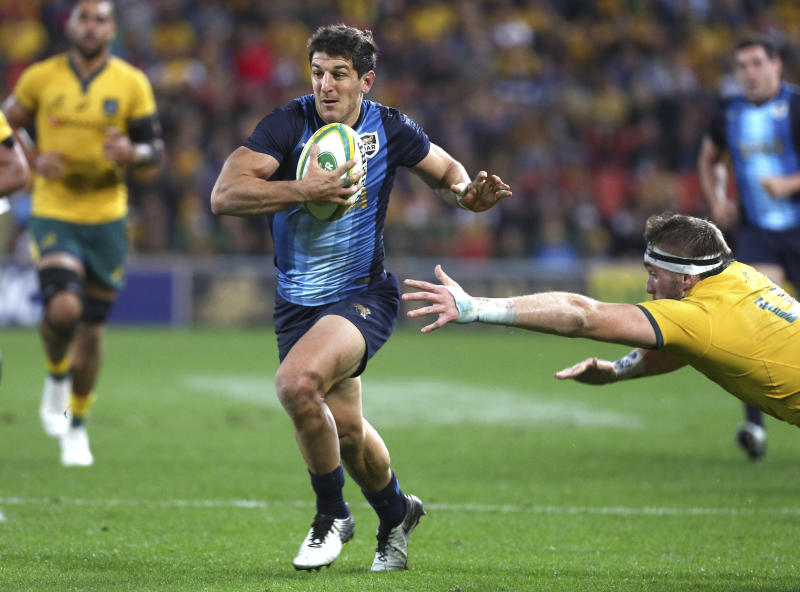 Argentina's Tomas Cubelli attacks during the Rugby Championship match between Australia and Argentina in Brisbane, Australia, Saturday July 27, 2019. (AP Photo/Tertius Pickard)