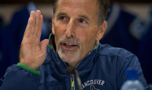 Vancouver Canucks NHL hockey head coach John Tortorella gestures during a media availability at Rogers Arena in Vancouver, Wednesday, Sept, 11, 2013. (AP Photo/The Canadian Press, Jonathan Hayward)