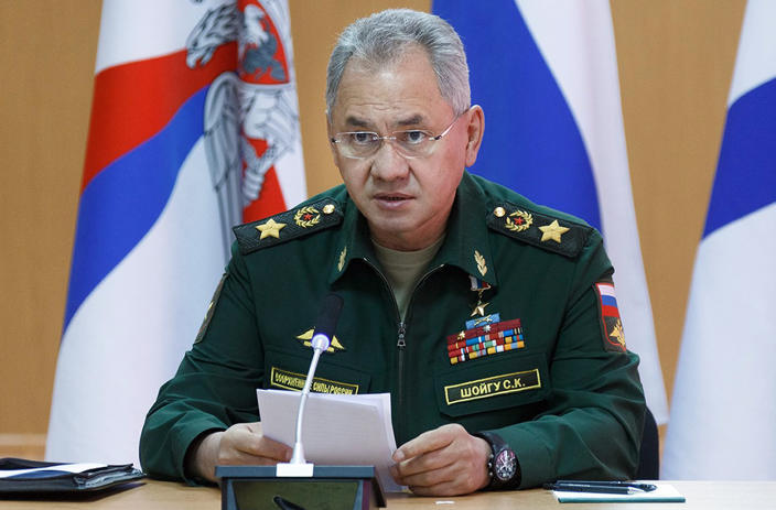 In this handout photo released by Russian Defense Ministry Press Service, Russian Defense Minister Sergei Shoigu speaks as he visits a naval base in in Gadzhiyevo, Russia, Tuesday, April 13, 2021. Shoigu on Tuesday described a massive military buildup in western Russia as part of drills intended to check the armed forces' readiness amid the threats posed by NATO. (Vadim Savitsky/Russian Defense Ministry Press Service via AP)