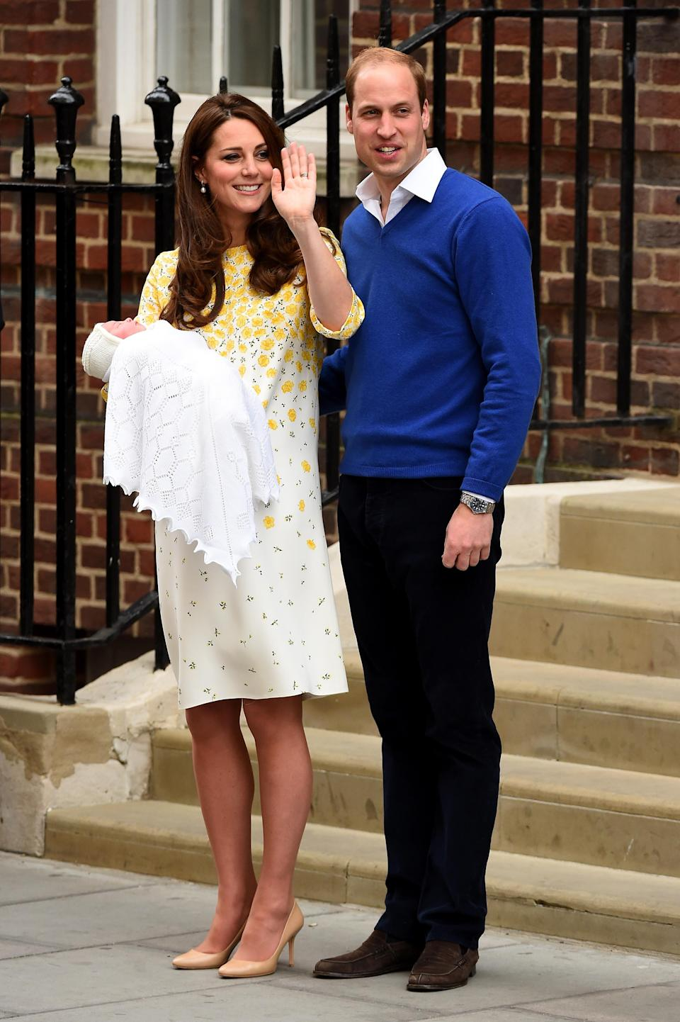 <p>Welcoming Princess Charlotte to the world, the Duchess chose a bespoke Jenny Packham dress complete with a sweet buttercup print. She paired the look with nude Jimmy Choo pumps. <em>[Photo: Getty]</em> </p>