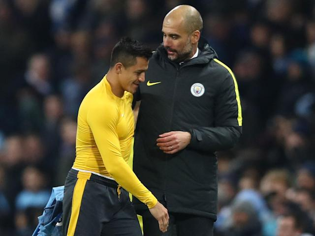 Guardiola with his former player Sanchez: Getty