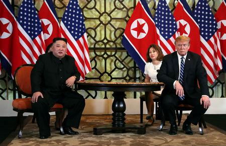 FILE PHOTO: North Korean leader Kim Jong Un and U.S. President Donald Trump listen to questions from the media during their one-on-one bilateral meeting at the second North Korea-U.S. summit in the Metropole hotel in Hanoi, Vietnam February 28, 2019. REUTERS/Leah Millis/File Photo