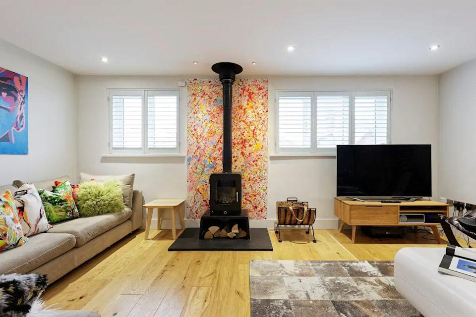 "<p>One for sharing with family or friends, this quirky and luxurious Airbnb is a great spot to soak up the seaside vibes of unequivocally picturesque Whitstable. There's a roomy kitchen/diner, scooters and bikes to borrow, an arcade games machine and a large garden - a rare find in Whitstable.</p><p><strong>Sleeps: </strong>8</p><p><strong>Make sure you... </strong>Bring the car and make it a road trip as there's a private driveway and garage.</p><p><strong>Price per night: </strong>£621</p><p><a class=""link rapid-noclick-resp"" href=""https://airbnb.pvxt.net/rnQbNB"" rel=""nofollow noopener"" target=""_blank"" data-ylk=""slk:BOOK HERE"">BOOK HERE</a></p>"