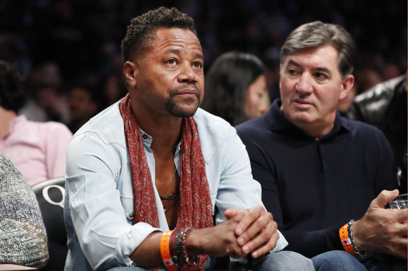 Actor Cuba Gooding Jr., left, sits in the front row with a friend during the first half of an NBA basketball game between the Brooklyn Nets and the Indiana Pacers, Monday, Nov. 18, 2019, in New York. (AP Photo/Kathy Willens)