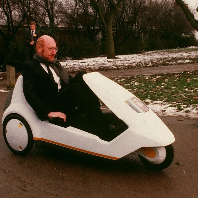 Inventor Sir Clive Sinclair demonstrates his battery-assisted pedal powered tricycle at Alexandra Palace, London January 10, 1985. - Credit: PA