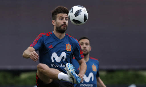 Spain's Gerard Pique controls the ball during a training session of Spain at the 2018 soccer World Cup in Krasnodar, Russia, Sunday, June 17, 2018. (AP Photo/Manu Fernandez)