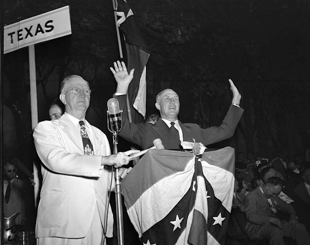 South Carolina Gov. Strom Thurmond raises his hands over his head in response to a tumultuous ovation accorded him by delegates to the Dixiecrats' States' Rights Convention in Birmingham, Ala., on July 17, 1948. (Photo: AP)