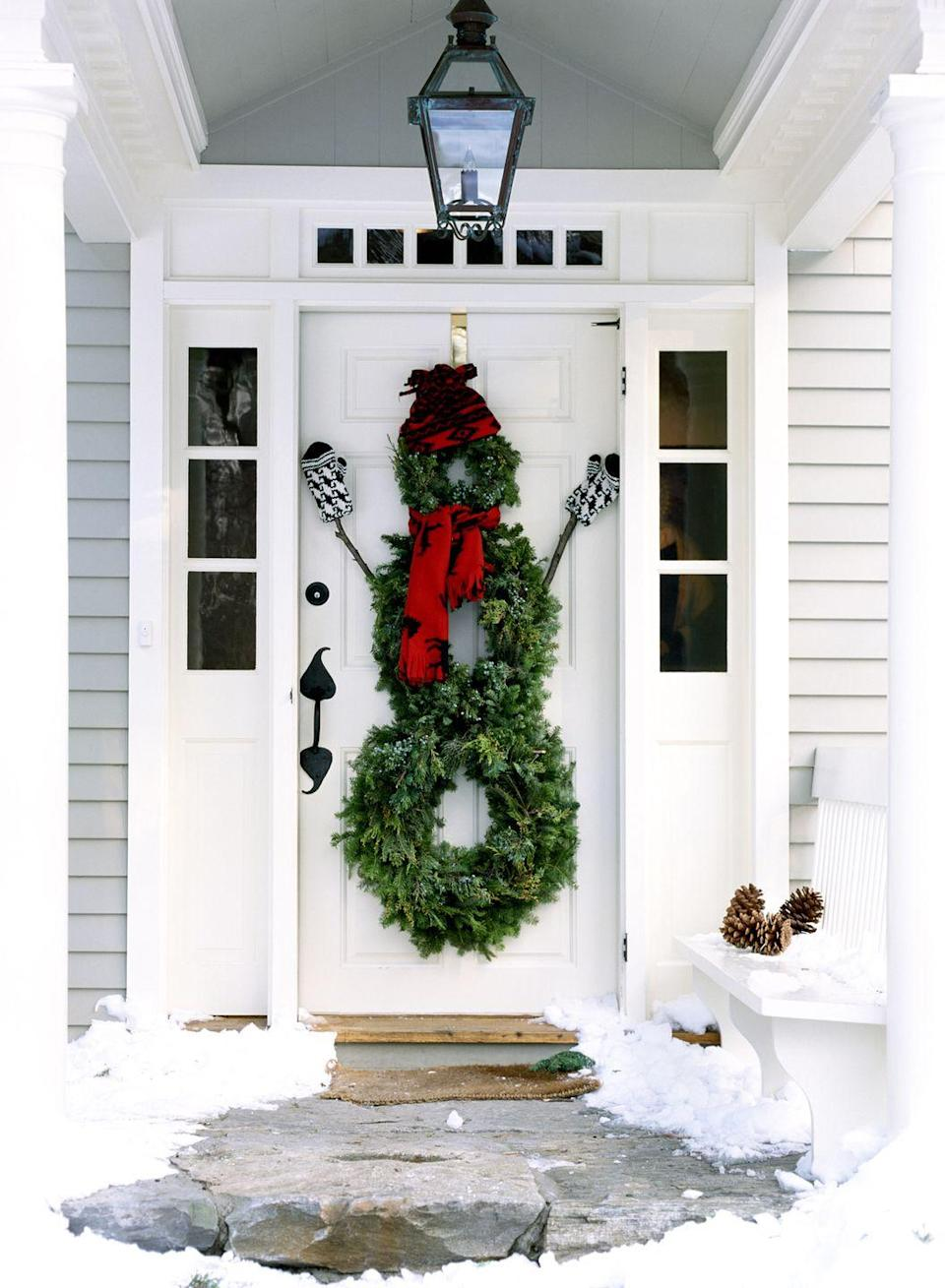 <p>Love the look of snowmen, but hate the idea of actually touching snow? Craft one out of three wreaths instead.</p>