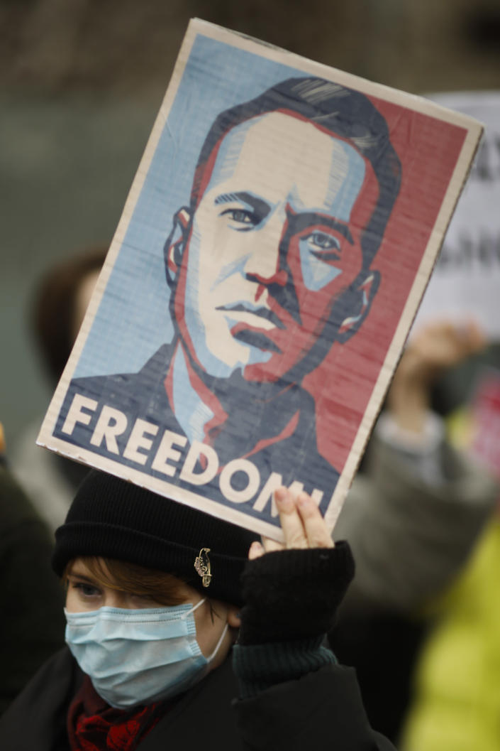 A woman shows poster with a drawing of Russian opposition leader Alexei Navalny, as she attends a protest against the jailing of the Russian opposition leader in front of the chancellery in Berlin, Germany, Saturday, Jan. 23, 2021. A Russian judge had ordered opposition leader Alexei Navalny jailed for 30 days, after the leading Kremlin critic returned to Russia from Germany where he was recovering from nerve agent poisoning. (AP Photo/Markus Schreiber)