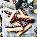 """<p>We've turned the famous Cumbrian confection into chocolate-dipped gifting bars. Swap the dark chocolate for milk or white, if you like things sweeter.</p><p><strong>Recipe: <a href=""""https://www.goodhousekeeping.com/uk/christmas/christmas-recipes/a37820370/kendal-mint-cake-bars/"""" rel=""""nofollow noopener"""" target=""""_blank"""" data-ylk=""""slk:Christmas Kendal Mint Cake Bars"""" class=""""link rapid-noclick-resp"""">Christmas Kendal Mint Cake Bars</a></strong></p>"""