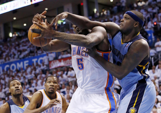 Oklahoma City Thunder center Kendrick Perkins (5) and Memphis Grizzlies forward Zach Randolph reach for a rebound in the second quarter of Game 5 of an opening-round NBA basketball playoff series in Oklahoma City, Tuesday, April 29, 2014. (AP Photo)