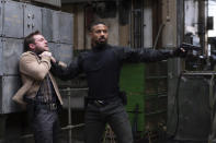 """This image released by Amazon shows Jamie Bell , left, and Michael B. Jordan in a scene from """"Tom Clancy's Without Remorse."""" (Nadja Klier/Amazon via AP)"""