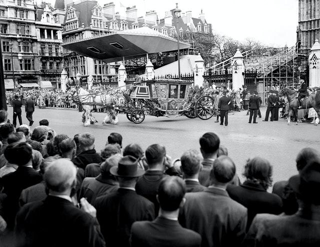 Crowds watching the Speaker's coach leave the Houses of Parliament for Westminster Abbey, for a Coronation rehearsal