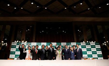 Tokyo Governor Yuriko Koike (4th R), the leader of her new Party of Hope, poses with her party members, including Goshi Hosono, a former environment minister and Masaru Wakasa, a former prosecutor who left the ruling Liberal Democratic Party, during a news conference to announce the party's campaign platform in Tokyo, Japan, September 27, 2017. REUTERS/Issei Kato