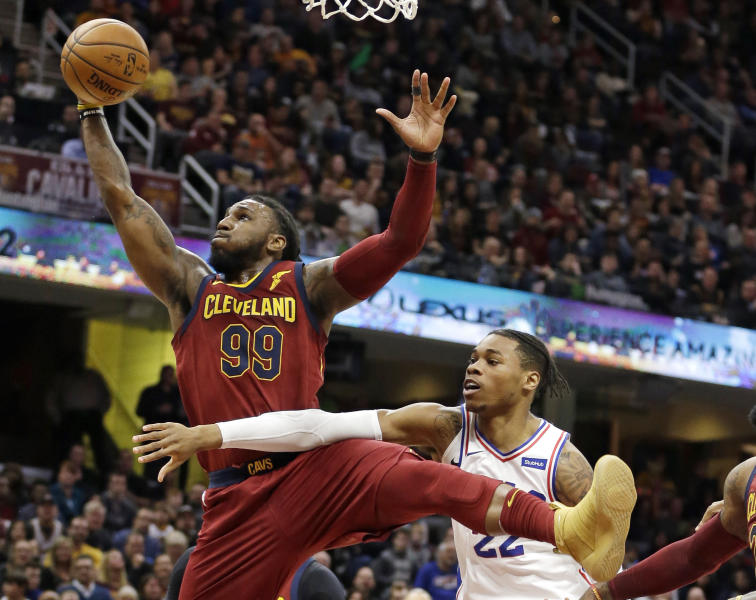 Cleveland Cavaliers' Jae Crowder (99) and Philadelphia 76ers' Richaun Holmes (22) vie for a rebound during the first half of an NBA basketball game, Saturday, Dec. 9, 2017, in Cleveland. (AP Photo/Tony Dejak)