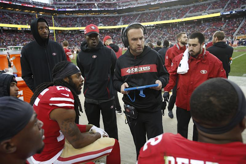 Defensive backs coach Jeff Hafley talks with San Francisco 49ers DBs on the sideline during a game against the Seattle Seahawks on Dec. 16, 2018. (Michael Zagaris/Getty Images)