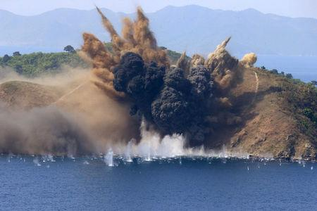 A target island off the coast of the Kalma International Airport in Wonsan, North Korea, is hit during a live-fire artillery drill August, 26 2017.  KCNA/via REUTERS