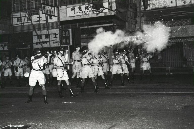 In this South China Morning Post (SCMP) archive photo taken on July 11, 1967, riot police shoot tear gas towards protesters, in North Point, Hong Kong