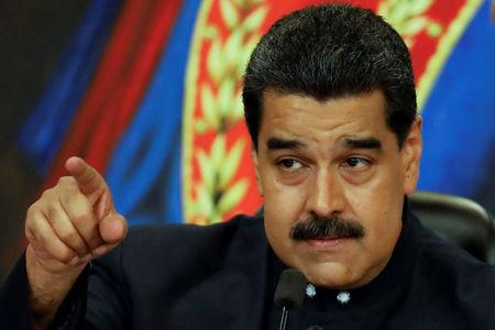 FILE PHOTO: Venezuela's President Nicolas Maduro gestures while he talks to the media during a news conference at Miraflores Palace in Caracas