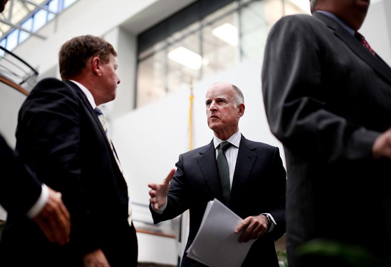 California Governor jerry Brown speaks with business leaders after speaking at Gen-Probe Incorporated in San Diego on Tuesday, Sept. 6th, 2011.  Brown says he is optimistic that lawmakers will agree this week to end a corporate tax loophole for companies based outside the state.  The governor's plan would force out-of-state companies that sell goods in California but do not employ many residents to pay more in taxes.   (AP Photo/Sandy Huffaker)