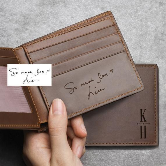 """<p><strong>ScriptLeather</strong></p><p>etsy.com</p><p><strong>$49.00</strong></p><p><a href=""""https://go.redirectingat.com?id=74968X1596630&url=https%3A%2F%2Fwww.etsy.com%2Flisting%2F653718203%2Fhandwriting-wallet-leather-wallet-for&sref=https%3A%2F%2Fwww.thepioneerwoman.com%2Fholidays-celebrations%2Fgifts%2Fg35057349%2Fvalentines-day-gifts-for-him%2F"""" rel=""""nofollow noopener"""" target=""""_blank"""" data-ylk=""""slk:Shop Now"""" class=""""link rapid-noclick-resp"""">Shop Now</a></p><p>You can customize both the inside and outside of this beautiful wallet with his name and a message of your choice. </p>"""