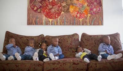 "What's life like with six toddlers in their ""terrible twos""? The McGhee sextuplets watch TV on the couch at home in Columbus, Ohio."