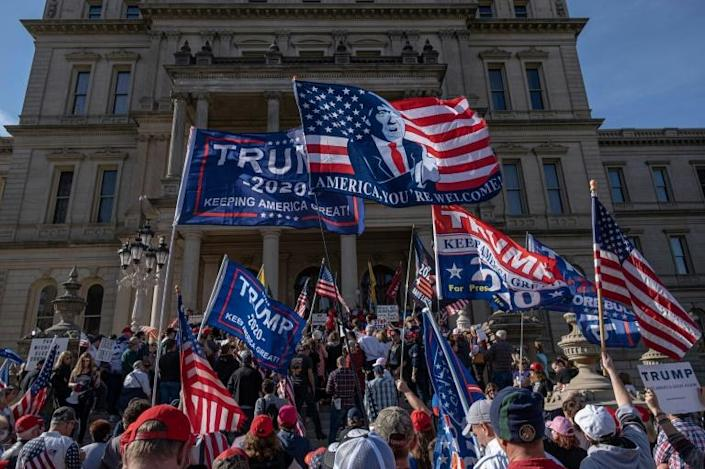 Donald Trump supporters rally at the State Capitol in Lansing, Michigan, after Joe Biden is declared winner of the presidential election