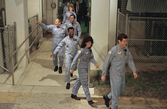 The crew for the Space Shuttle Challenger flight 51-L leaves their quarters for the launch pad, Jan. 27, 1986, at the Kennedy Space Center in Florida. Front to back are Commander Francis Scobee, Mission Spl. Judith Resnik, Mission Spl. Ronald McNair, Payload Spl. Gregory Jarvis, Mission Spl. Ellison Onizuka, teacher Christa McAuliffe, and pilot Michael Smith. (AP Photo/Steve Helber)