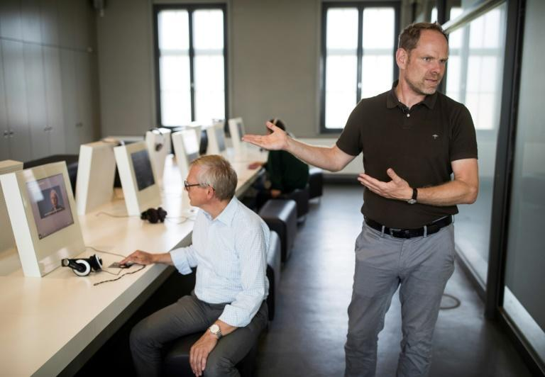 Director of the Sachsenhausen camp's memorial, Axel Drecoll (R), says memorials need to evolve to defend their mission and prepare for a time when there are no more Holocaust survivors alive to bear witness (AFP Photo/Odd ANDERSEN)