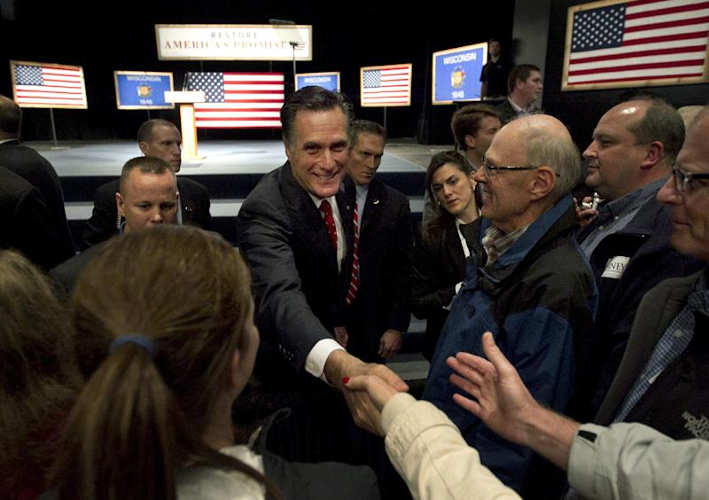 Republican presidential candidate, former Massachusetts Gov. Mitt Romney greets the audience during a campaign stop at Lawrence University in Appleton, Wis., Friday, March 30, 2012. (AP Photo/Steven Senne)