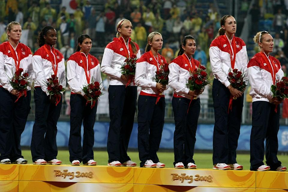 """<p>Over the next eight years, the US went 77-4 in international competition and won another Olympic gold medal. It was about as dominant a performance as the team could ask for, but in a foreshadowing of things to come, three of those four losses came at the hands of Japan.</p> <p>In the 2008 Olympics, the US looked unbeatable once again, outscoring opponents 57-2 through the first eight games. The US had beaten Japan twice in pool play before the teams met again in the gold medal game. Then, with ace <a href=""""https://www.popsugar.com/fitness/who-is-cat-osterman-facts-about-usa-softball-pitcher-48432116"""" class=""""link rapid-noclick-resp"""" rel=""""nofollow noopener"""" target=""""_blank"""" data-ylk=""""slk:Cat Osterman"""">Cat Osterman</a> on the mound for the Americans, Japan shocked the US by scoring three runs while holding the high-powered American offense at bay with a dominant pitching performance by Yukiko Ueno. Japan won the game, handing the US its first Olympic loss in eight years and its first silver medal. To make matters worse for the US, the International Olympic Committee had already announced that 2008 would be the last Olympics to feature softball. The Americans would not have an opportunity to avenge the loss.</p>"""