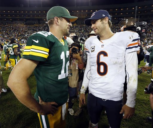 Green Bay Packers' Aaron Rodgers (12) talks to Chicago Bears' Jay Cutler (6) after the second half of an NFL football game Thursday, Sept. 13, 2012, in Green Bay, Wis. The Packers won 23-10. (AP Photo/Mike Roemer)