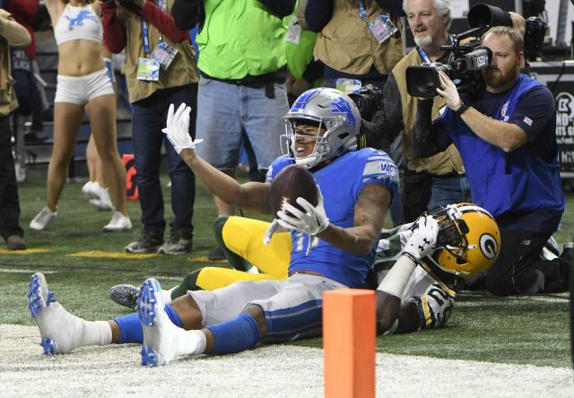<p>Detroit Lions wide receiver Marvin Jones (11), defended by Green Bay Packers strong safety Kentrell Brice (29), calls for teammates after catching a pass for a touchdown during the first half of an NFL football game, Sunday, Dec. 31, 2017, in Detroit. (AP Photo/Jose Juarez) </p>