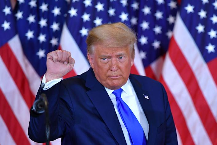 US President Donald Trump pumps his fist after speaking during election night in the East Room of the White House in Washington, DC, early on November 4, 2020.