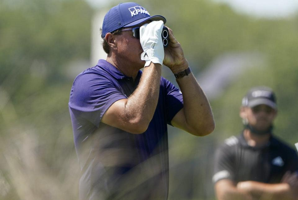 """<span class=""""caption"""">Phil Mickleson uses a rangefinder at the PGA Championship golf tournament.</span> <span class=""""attribution""""><span class=""""source"""">(AP Photo/Chris Carlson) </span></span>"""