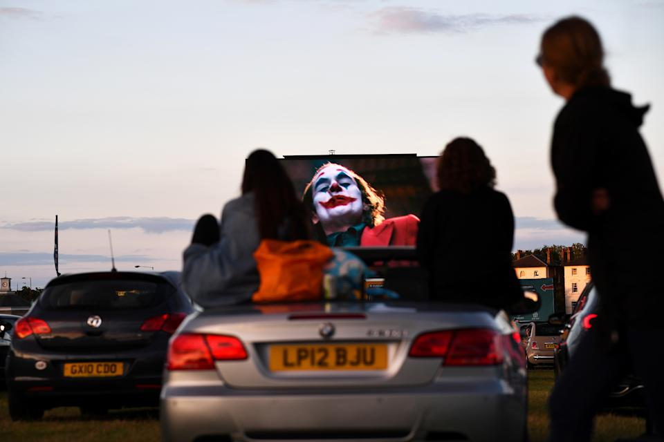 People watch the film