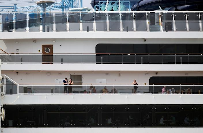 13 Tourists are seen at Cruise liner MSC Meraviglia, while berthed at a dock in Punta Langosta after two Caribbean ports denied the ship entry due to fears, later disproven, that a crew member was infected with the coronavirus, in Cozumel